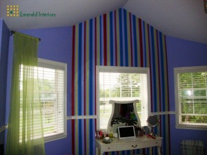 Painted stripes, whimsical drapes for teen's room