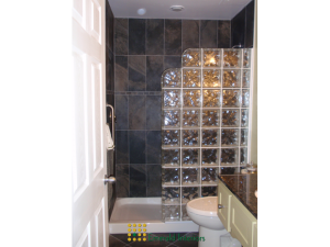 Tiled shower with glass block wall to complete the picture